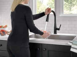 black stainless steel faucet water saving feature